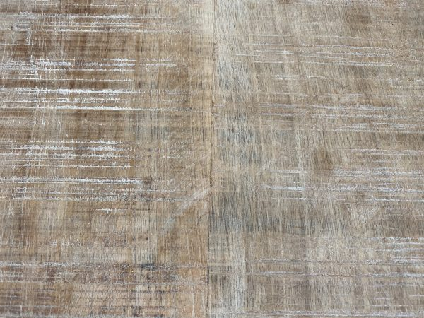 close up image of table top finish in distressed natural mango wood